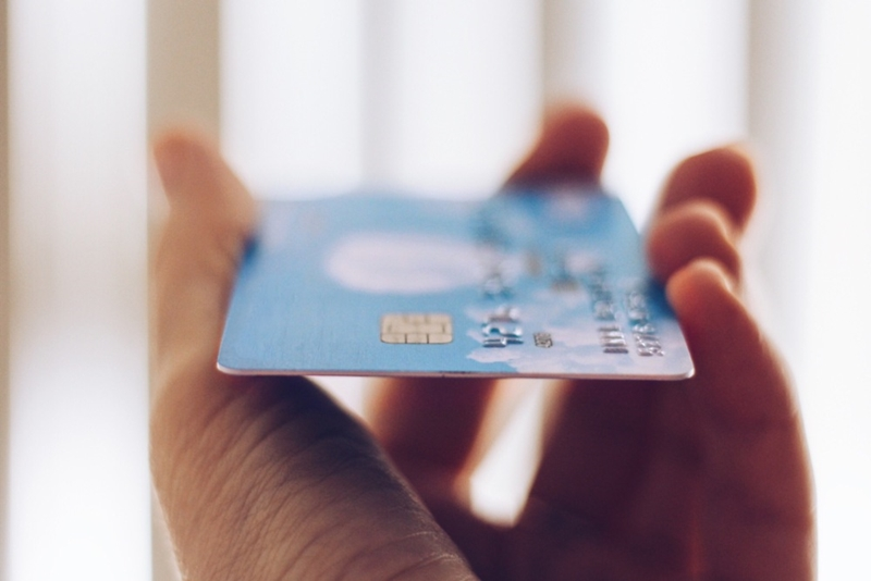 A credit card in a person's hand.